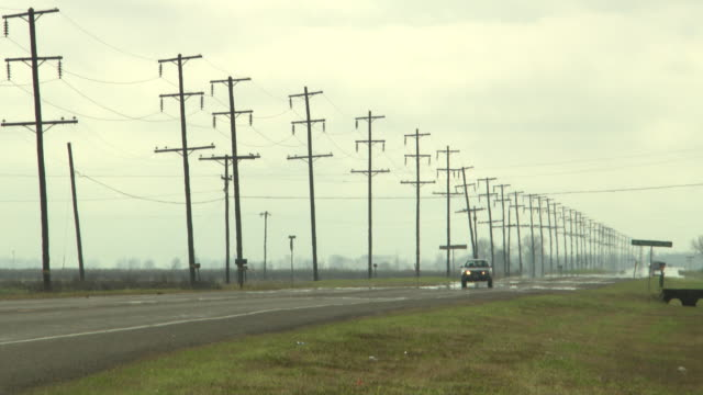 WS View of Power cables running alongside quiet road / New Orleans, Louisiana, United States