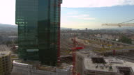 WS AERIAL DS View of prime tower under construction and Hardbrucke / Zurich city, Zurich, Switzerland