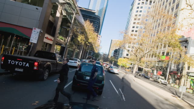 MS POV T/L View of Psychedelic city traffic, pedestrians and cars moving morphing strangely / Melbourne, Victoria, Australia
