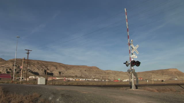 View of railway level crossing gate closing down in Wyoming United States