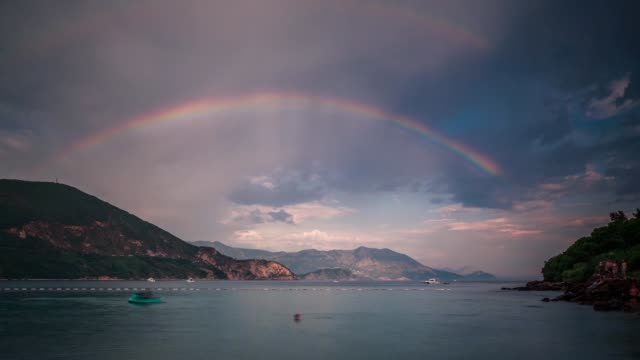 View of rainbow over bay