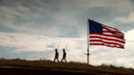 WS View of Reenactment Two American soldiers march away after Star Spangled Banner is raised above Fort McHenry / Baltimore, Maryland, United States