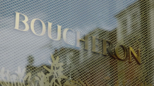 CU R/F View of reflection in window to focus on Boucheron sign / London, United Kingdom
