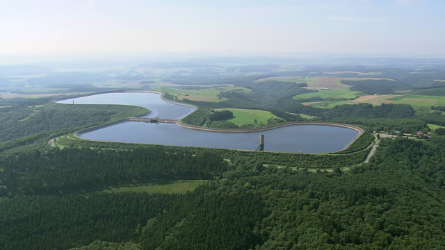 WS AERIAL PAN TS View of Reservoir (full) & river / Luxembourg