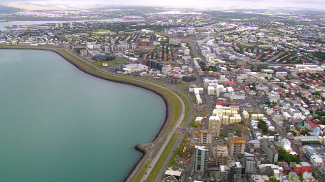 WS AERIAL View of Reykjavik cityscape near bay / Iceland