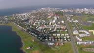 WS AERIAL View of Reykjavik town with coastline / Iceland