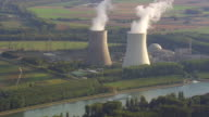 WS AERIAL View of Rhine river and cooling towers with farmland / Germany
