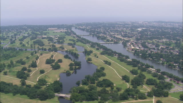 WS AERIAL View of River between city / Louisiana, United States