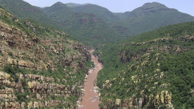 WS AERIAL View of river flowing and mountains / Polokwane, North West Province, South Africa