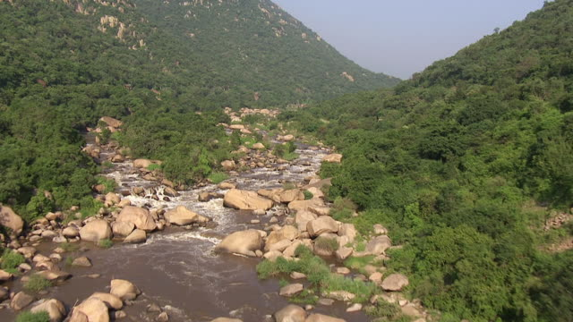 MS AERIAL View of river flowing between boulders / Nelspruit, Mpumalanga, South Africa