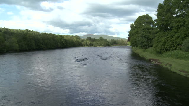 WS View of river flowing / Charlestown of Aberlour, Speyside, Scotland
