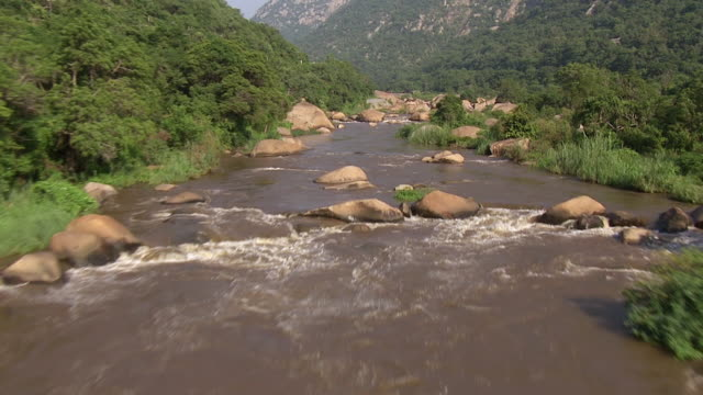 MS AERIAL TS View of river flowing through boulders / Nelspruit, Mpumalanga, South Africa