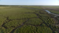 WS AERIAL View of river flowing through marshes / Kwazulu Natal, South Africa