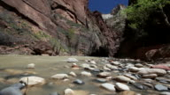 MS PAN View of river water with flat stones / Zion National Park, Utah, United States