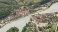 WS AERIAL View of river with bridge at Seyssel city / Rhone Alpes, France