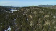 WS POV AERIAL View of rocky outcrop on ridgeline in Rocky Mountains near Evergreen / Denver, Colorado, USA