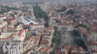 WS POV View of Rossio and Restauradores with cityscape / Lisbon, Portugal