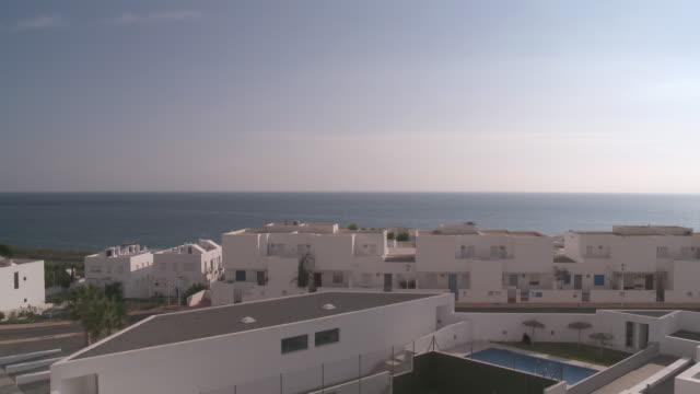WS View of Row houses against sea near Cabo de Gata Natural Park / Las Negras, Andalusia, Spain