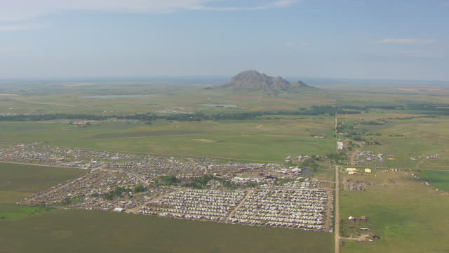 WS AERIAL View of rows of campers with Bear Butte in back side / Sturgis, South Dakota, United States