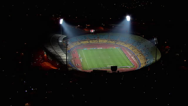 MS AERIAL ZO View of Royal Bafokeng Stadium at night / Rustenburg, North West Province, South Africa
