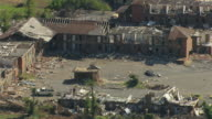 WS AERIAL View of rubble and ruins of tornado damaged homes and pull out to reveal larger damage / Tuscaloosa, Alabama, United States