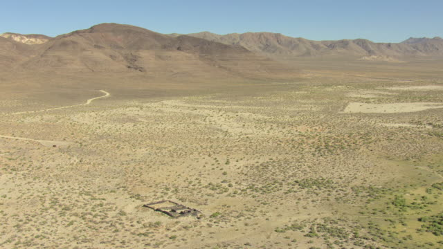 WS AERIAL View of ruins at Sand Springs Pony Express Station in Churchill County with desert valley and mountains / Nevada, United States