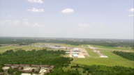 WS AERIAL View of Runway and airplane / Texas, United States