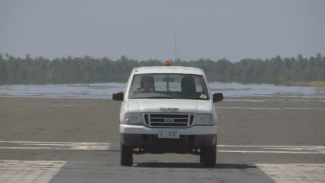 WS View of Runway Maintenance Service on Remote Airstrip / Keeling, Shire of Cocos, Australia