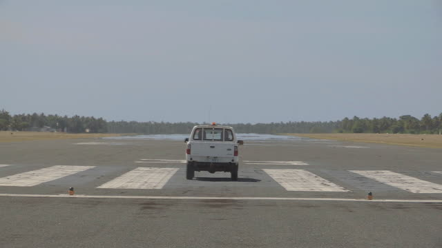MS View of Runway Maintenance Service on Remote Airstrip / Keeling, Shire of Cocos, Australia