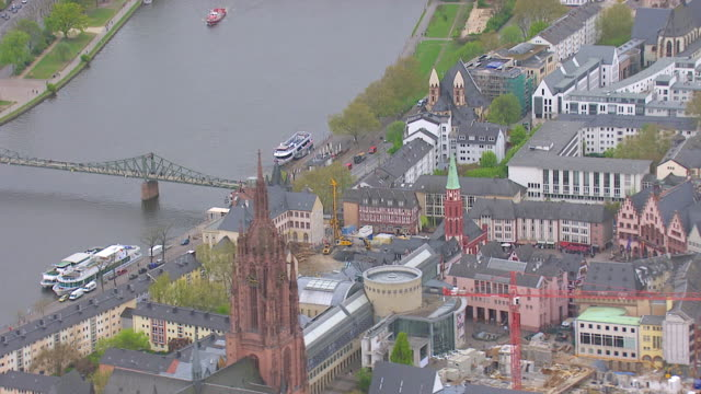 MS AERIAL View of Saint Bartholomew's Cathedral and construction site besides busy street / Frankfurt Main, Hesse, Germany