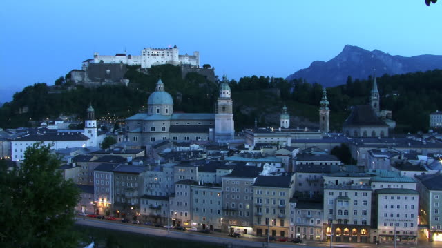 T/L, HA, WS, View of Salzburg with Festung Hohensalzburg (Salzburg Fortress) in distance, dusk to night, Austria