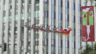 ZI MS View of Santa's sleigh and raindeer suspended above Wilshire Blvd. in Beverly Hills / Los Angeles, California
