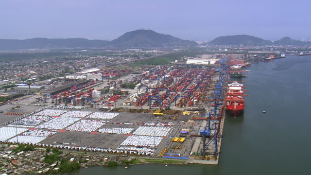 Ws Aerial View Of Santos Port With Mountain Range Sao ...