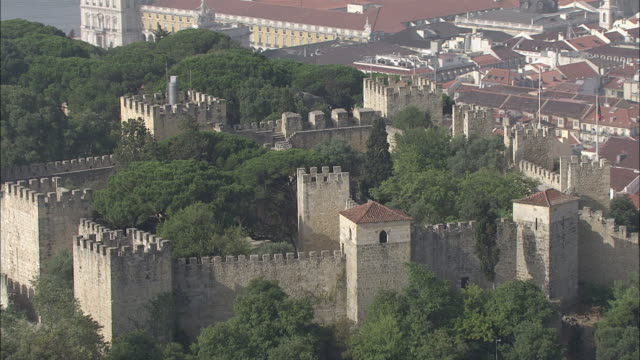 WS POV View of Sao Jorge castle surrounded with houses / Lisbon, Portugal