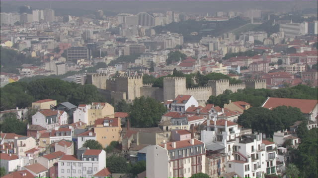 WS POV View of Sao Jorge castle with cityscape in background / Lisbon, Portugal