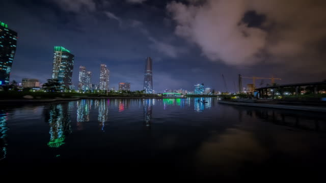 WS POV T/L View of Scenery of the Songdo City via water taxi at night / Incheon, South Korea