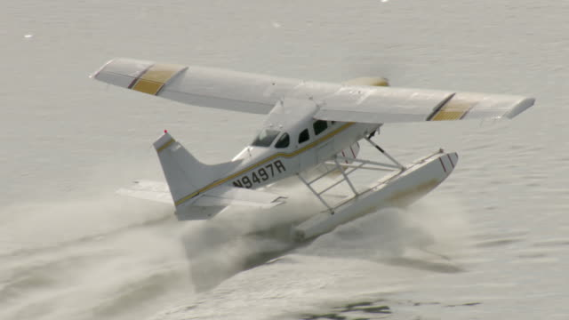 MS AERIAL TS ZO View of sea airplane take off from Naknek river / Alaska, United States