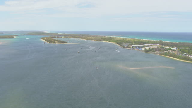 WS AERIAL ZI View of seaplane and boats in ocean / Kings Cliff, New South Wales, Australia