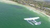 WS AERIAL TS View of seaplane flying over beach / Kings Cliff, New South Wales, Australia