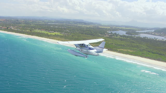 WS AERIAL View of seaplane flying over / Kings Cliff, New South Wales, Australia