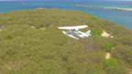 WS AERIAL ZI TS View of seaplane flying over / Kings Cliff, New South Wales, Australia