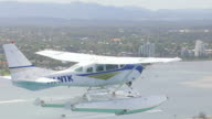 WS AERIAL TS View of seaplane flying over / Kings Cliff, New South Wales, Australia
