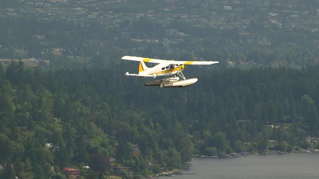 WS AERIAL ZI TS View of seaplane flying over lake / Washington, United States