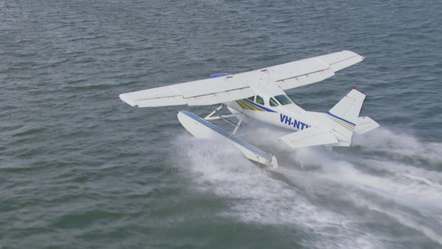 WS AERIAL TS View of seaplane taking off / Kings Cliff, New South Wales, Australia