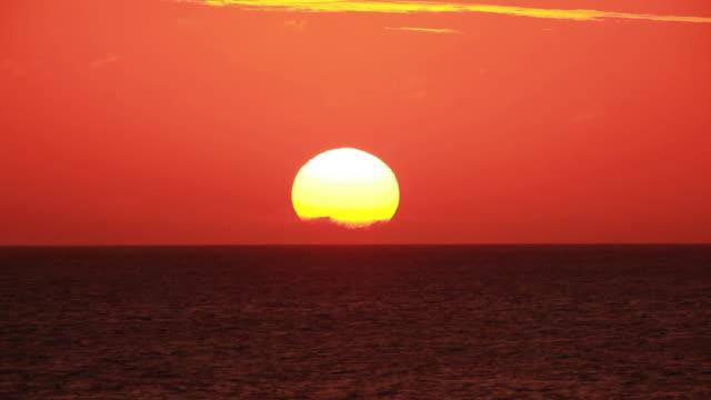 MS View of seascape against setting sun / Hagi, Yamaguchi, Japan