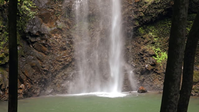 MS View of Secret Falls through trees / Wailua, Kauai, Hawaii, United States