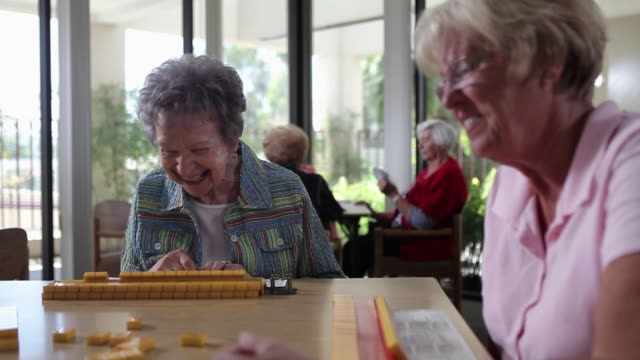 MS CU view of Senior Ladies playing in Mahjong / Laguna Woods,CA,United States