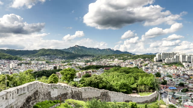 View of Seoul City Wall (also called as Hanyangdoseong and it's Korea Historic Place 10), Bukhansan mountain and cityscape of Seongbuk-dong