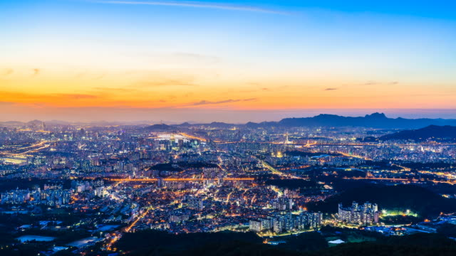 WS T/L View of Seoul cityscape and cloudscape at sunset to night / Seoul, South Korea
