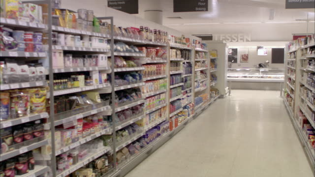 WS POV View of shelves in supermarket / North Finchley, London, UK